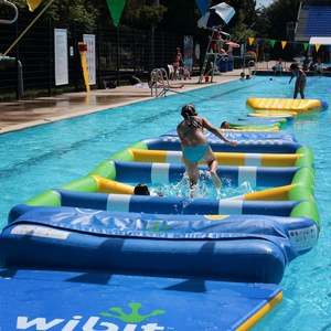 Inflatable water games at the Aquatic Complex, parc Jean-Drapeau